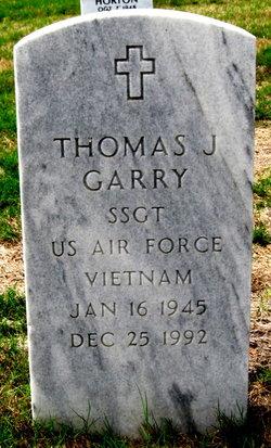 Thomas J Garry