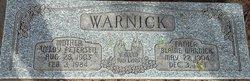 Veloy P Warnick